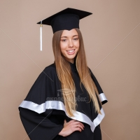 Black matte graduation gown with cap and tassel on it